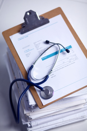 Medical stethoscope on the stack of paper .